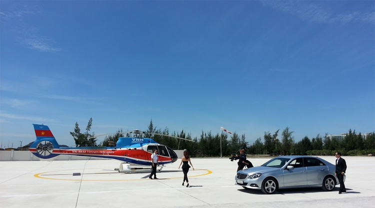 luxury helicopter and car